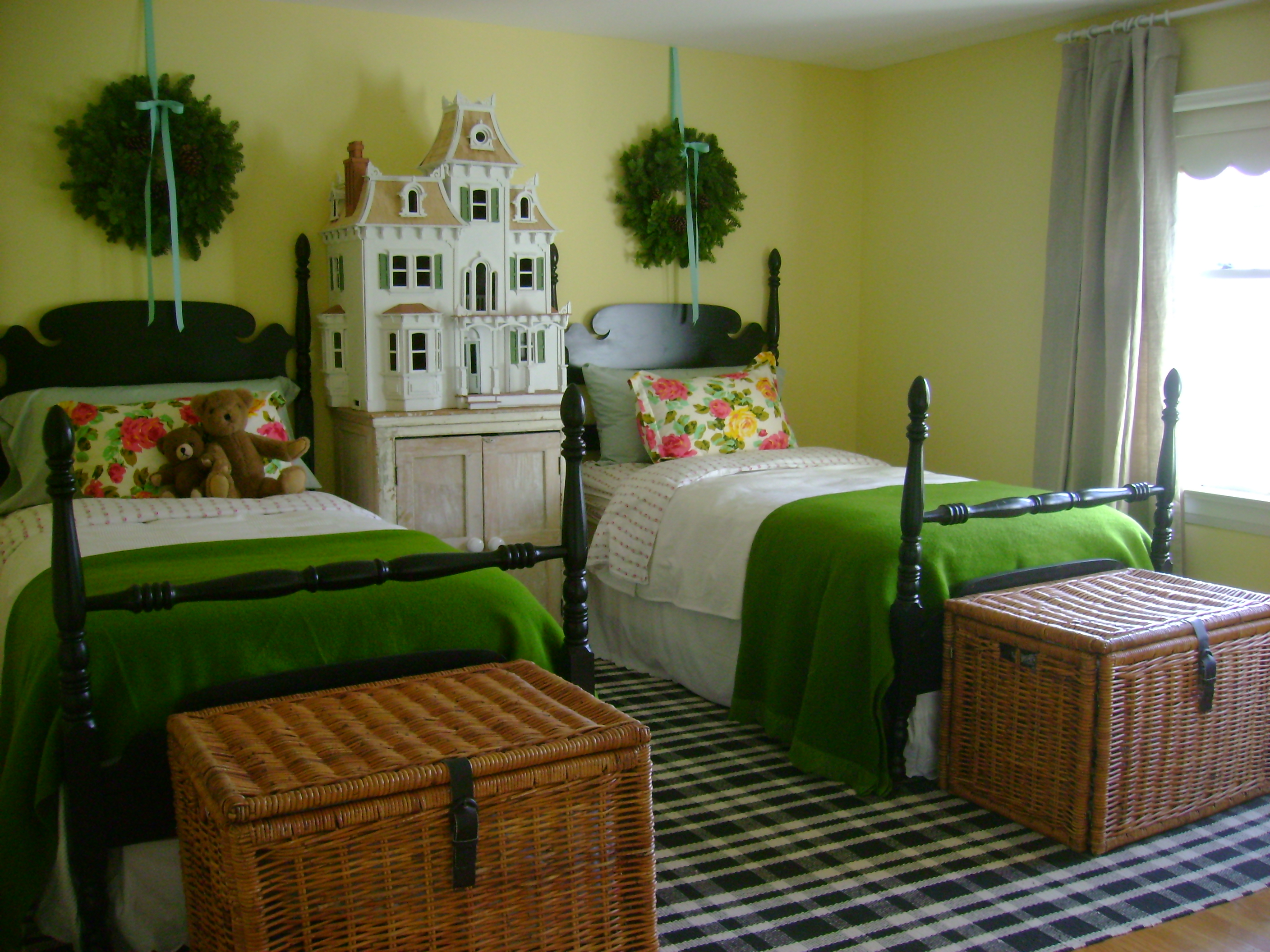 The guest room with cozy wool blankets and Sara's dollhouse and wreaths for that festive feeling
