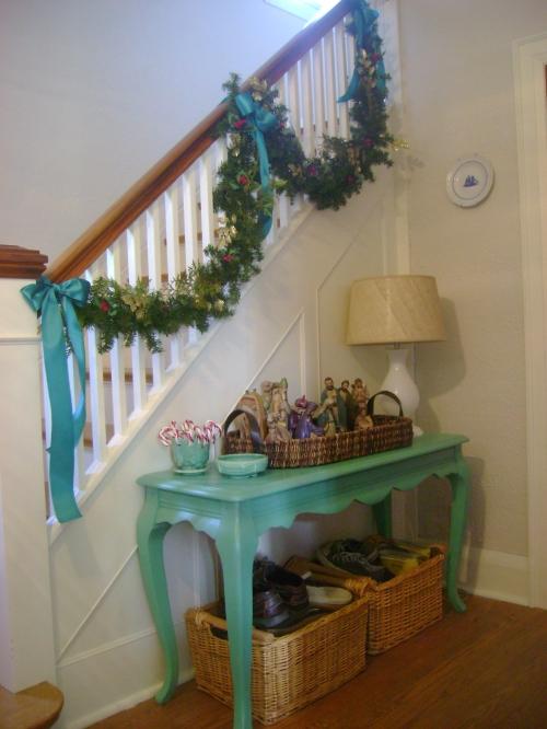 Sara's grandma's nativity set and an inexpensive garland decorate the hall.