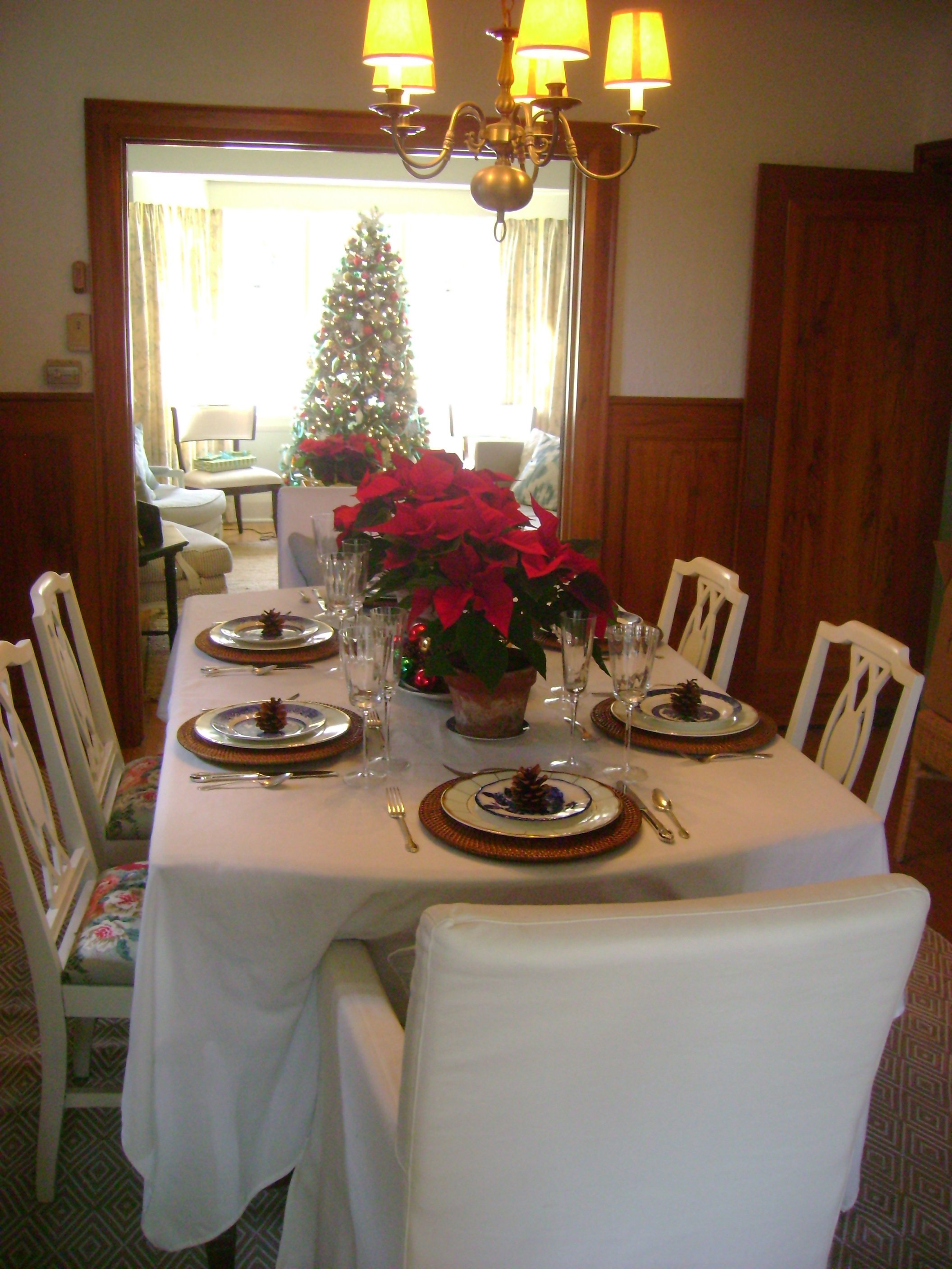 A view of the dining table through to the Christmas tree