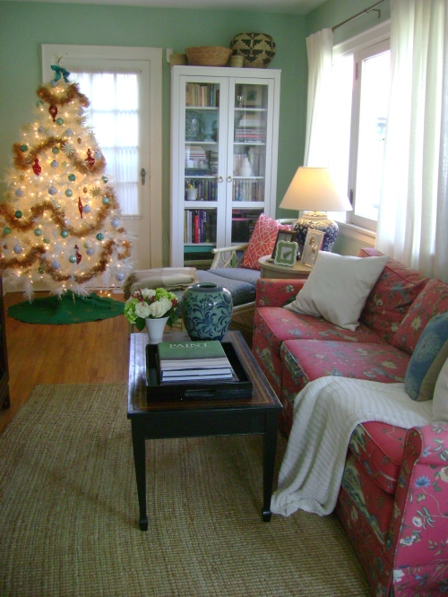 A second tree in the den with a bold gold garland to boot!